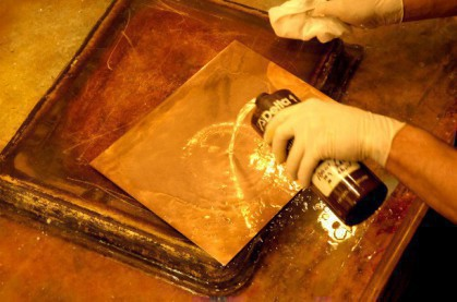 Tarnish is removed from the plate with a dilute acid.