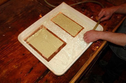 The plates are placed in a tray of hot water.