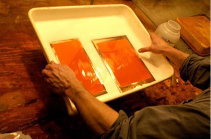 After development the plates are treated in a bath of alchohol to ensure even drying of the tissue